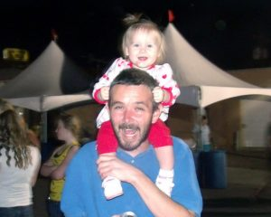Getting my hair ripped out by the happy little Karli at the Eyes to the Sky Balloon glow 06/21/2014.