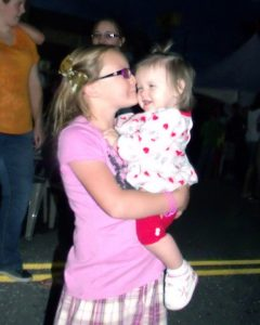 My niece Tangila giving baby Karli a kiss on the cheek at the Eyes to the Sky balloon glow 06/21/14.